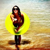 caity, yellow tube at beach